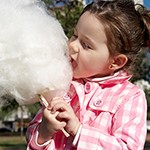 girl eating candy-floss