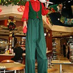 E8_578x800_Holiday Stiltwalker
