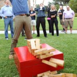 Team-Action-Shot-Jenga-Fallen-Tower-Adult